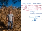 Ludwin Navarrete, 38 years old. His brothers are all in the U.S., but he never desired to move there. He believe in his land and in the work he can do here. Here, he is posing in his farm. Family tree handmade by the protagonist. In red, people who live in the U.S.' names, and in blue, the ones living in El Salvador. Intipucá, El Salvador. February/ March, 2019.