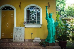 At Hugo Salinas and his uncle Alcides Andrade house. The liberty statue has been brought from the US. El Salvador, Intipuca - September 2017